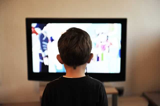 a little boy watching television