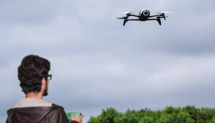 Young man holding a drone