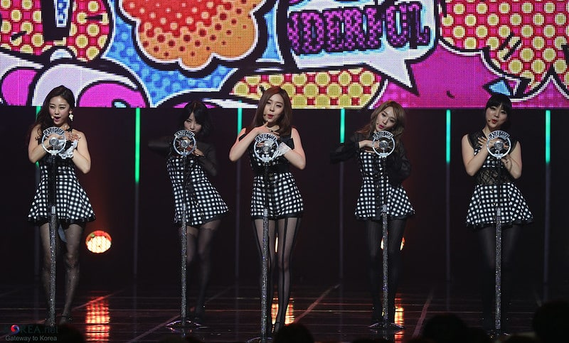 group of girl artists performing on stage